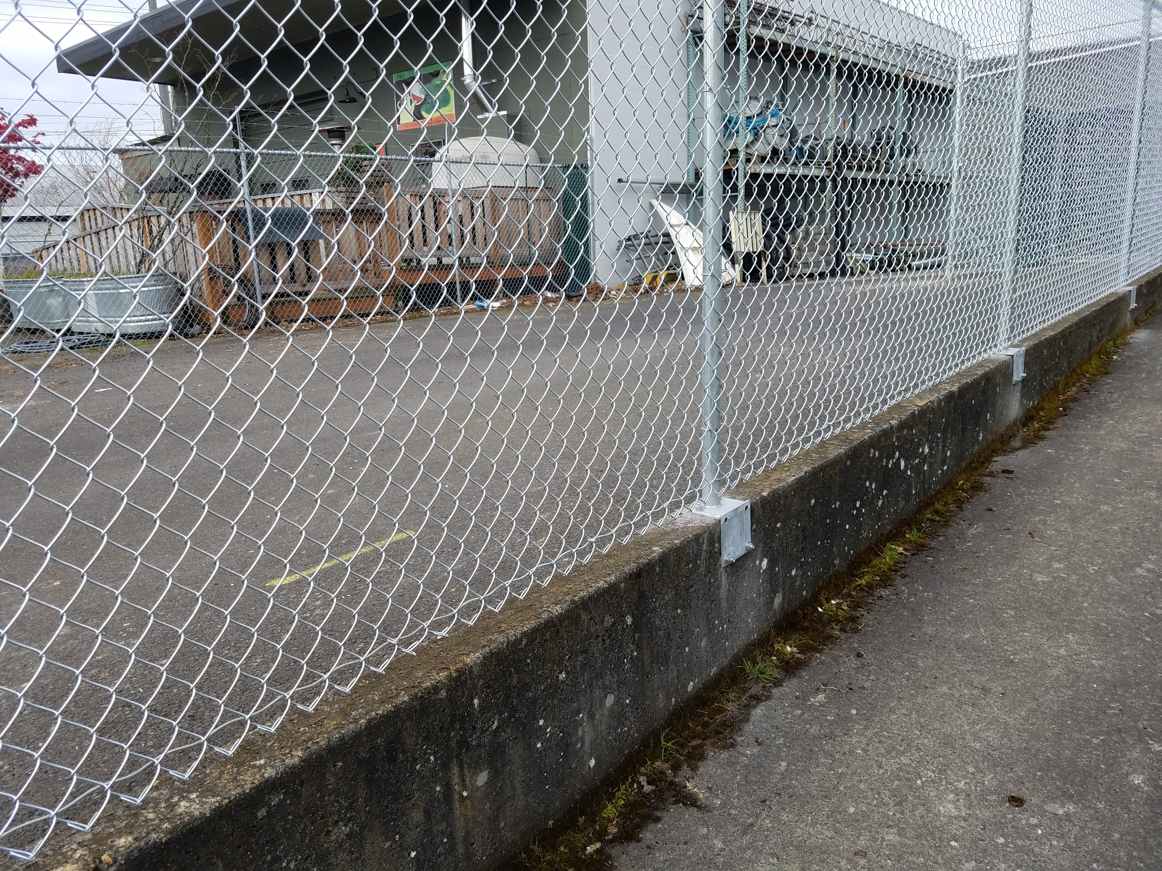 commercial chain link on concrete wall