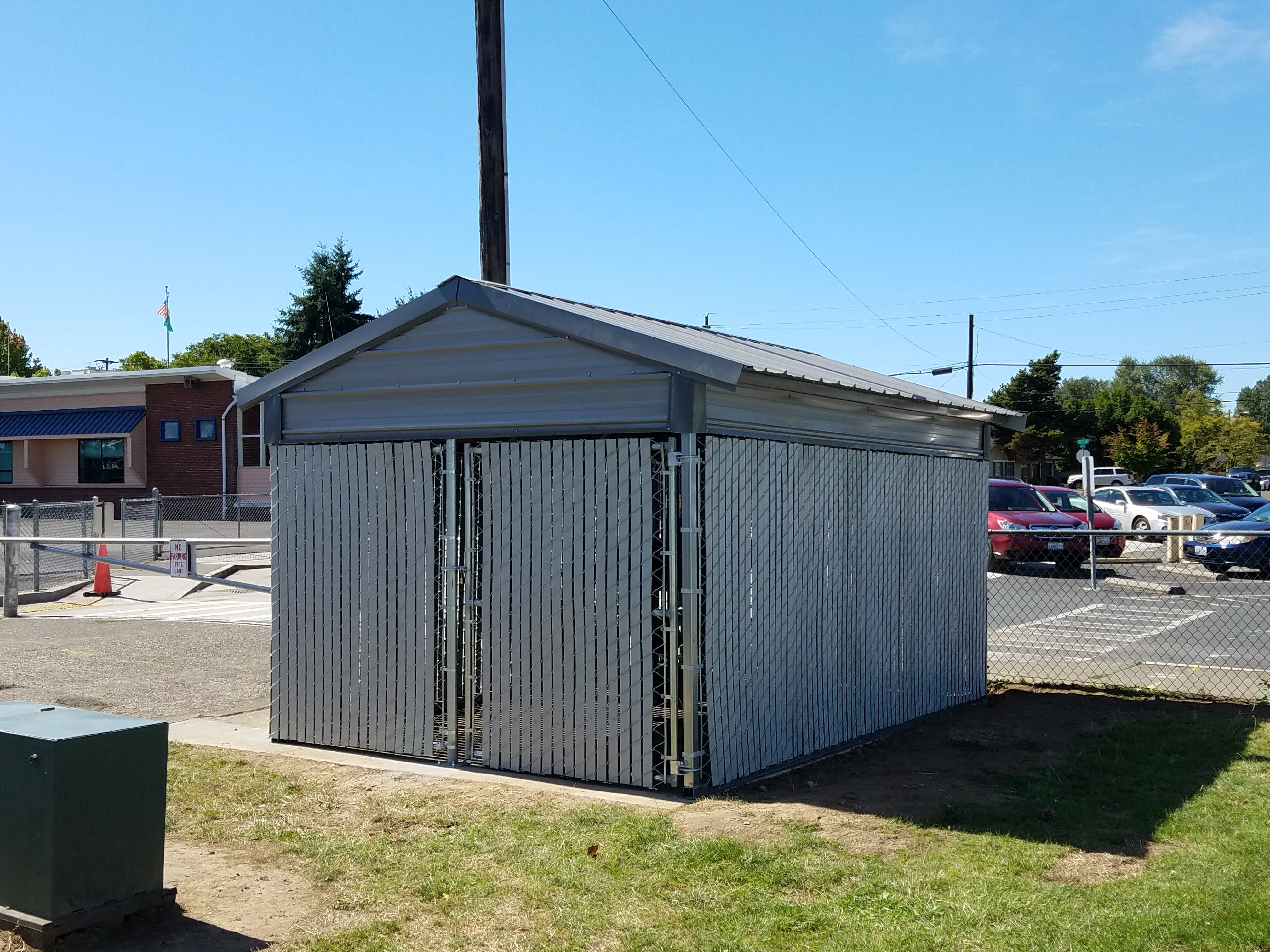 commercial slatted privacy chain link with metal building
