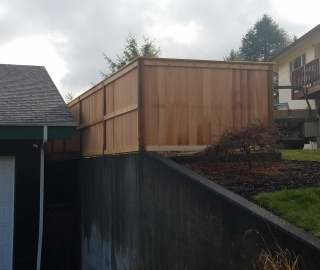 residential 6ft cedar on concrete wall