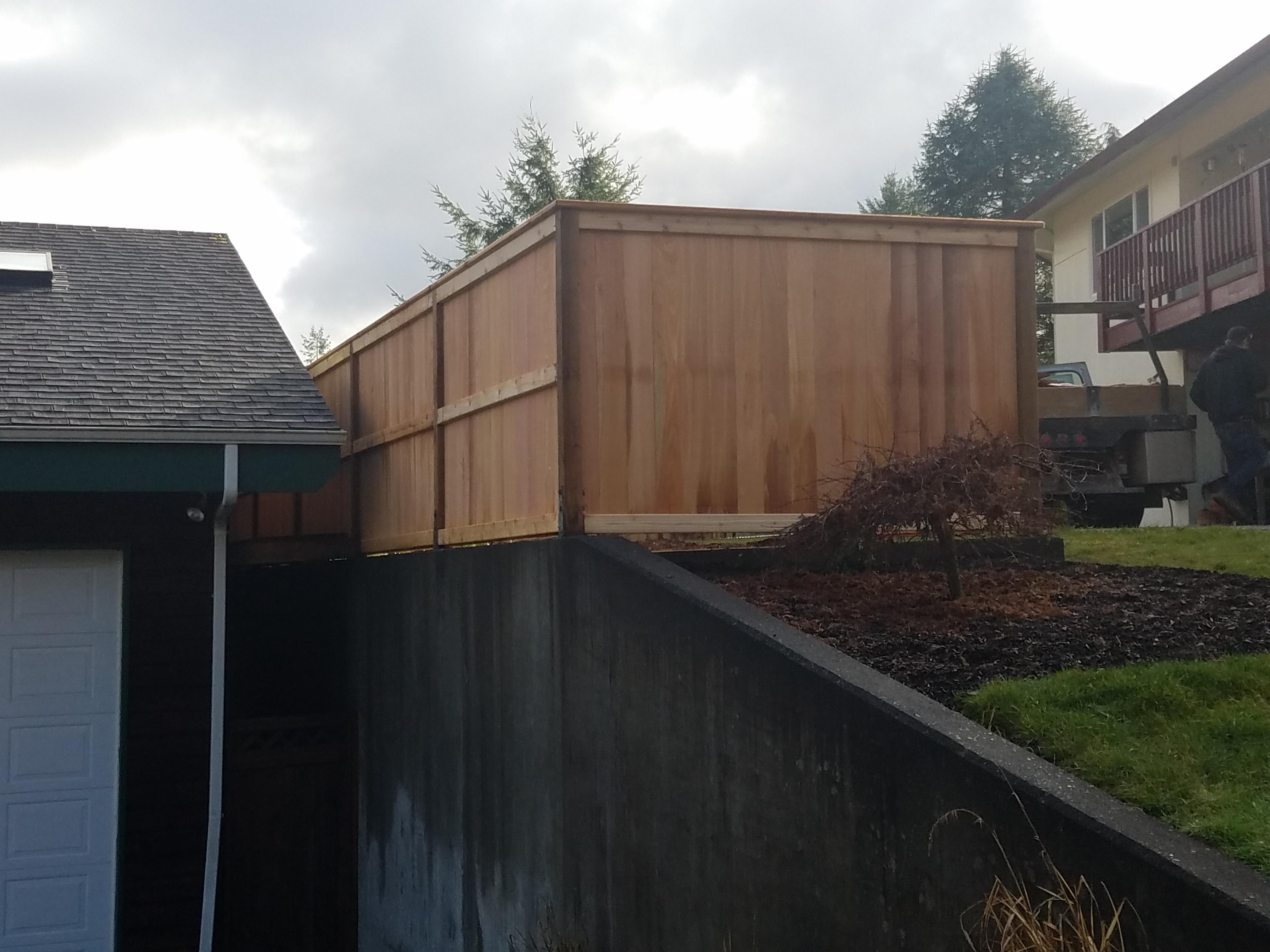residential 6ft cedar on concrete wall