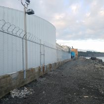 Industrial chain link on concrete wall for Tesoro