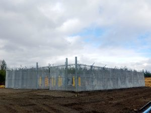 Industrial, security fence around natural gas pipeline