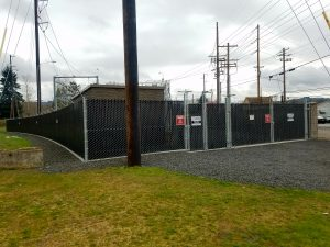 Commercial, privacy, slatted fence around PUD substation